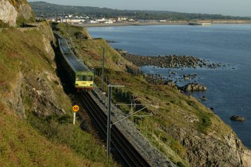 Local train near the sea in Ireland