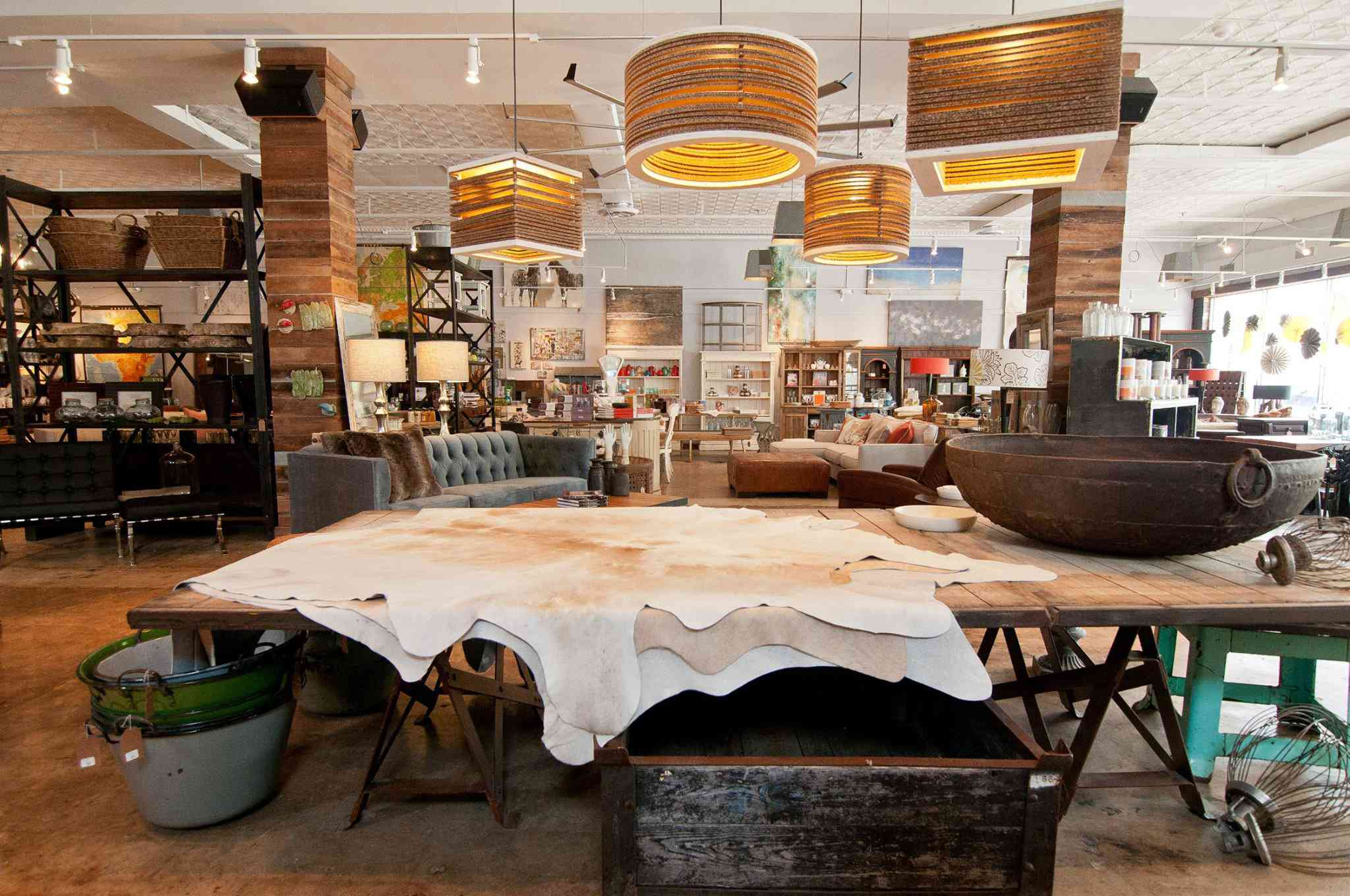 home good store with tanned hides, sofas, assorted light fixtures and more