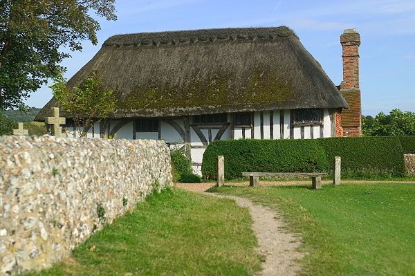 Tudor-style, thatched cottage in East Sussex England