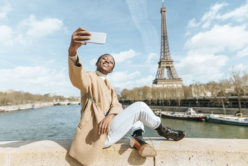 A woman taking a selfie in Paris