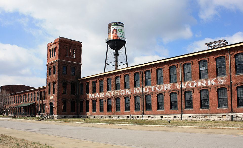 Exterior of the red brick Marathon Motor Works building with water tower