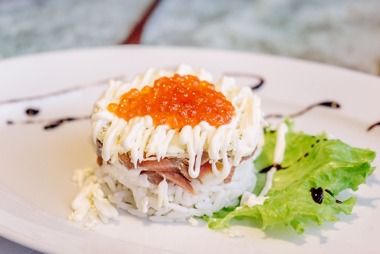 Russian food: a rice and fish salad with red caviar