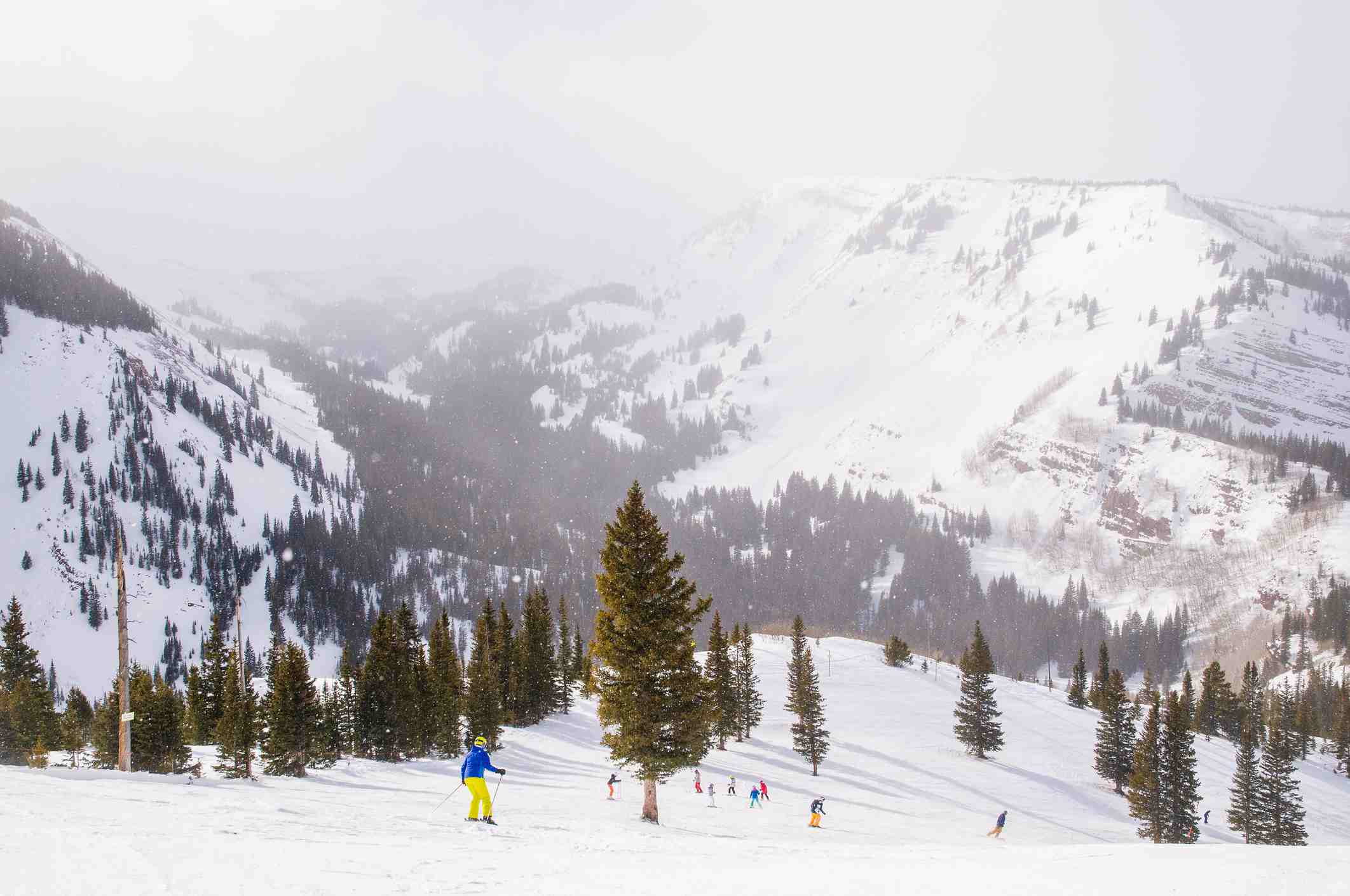 Skiers and snowboarders enjoying the slopes of Snowmass