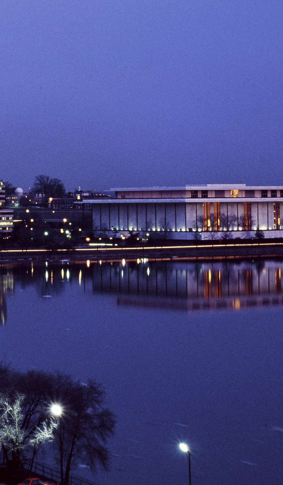 Dusk in Washington, DC, Potomac River with Washington Monument to left and Kennedy Center to the right, by the river