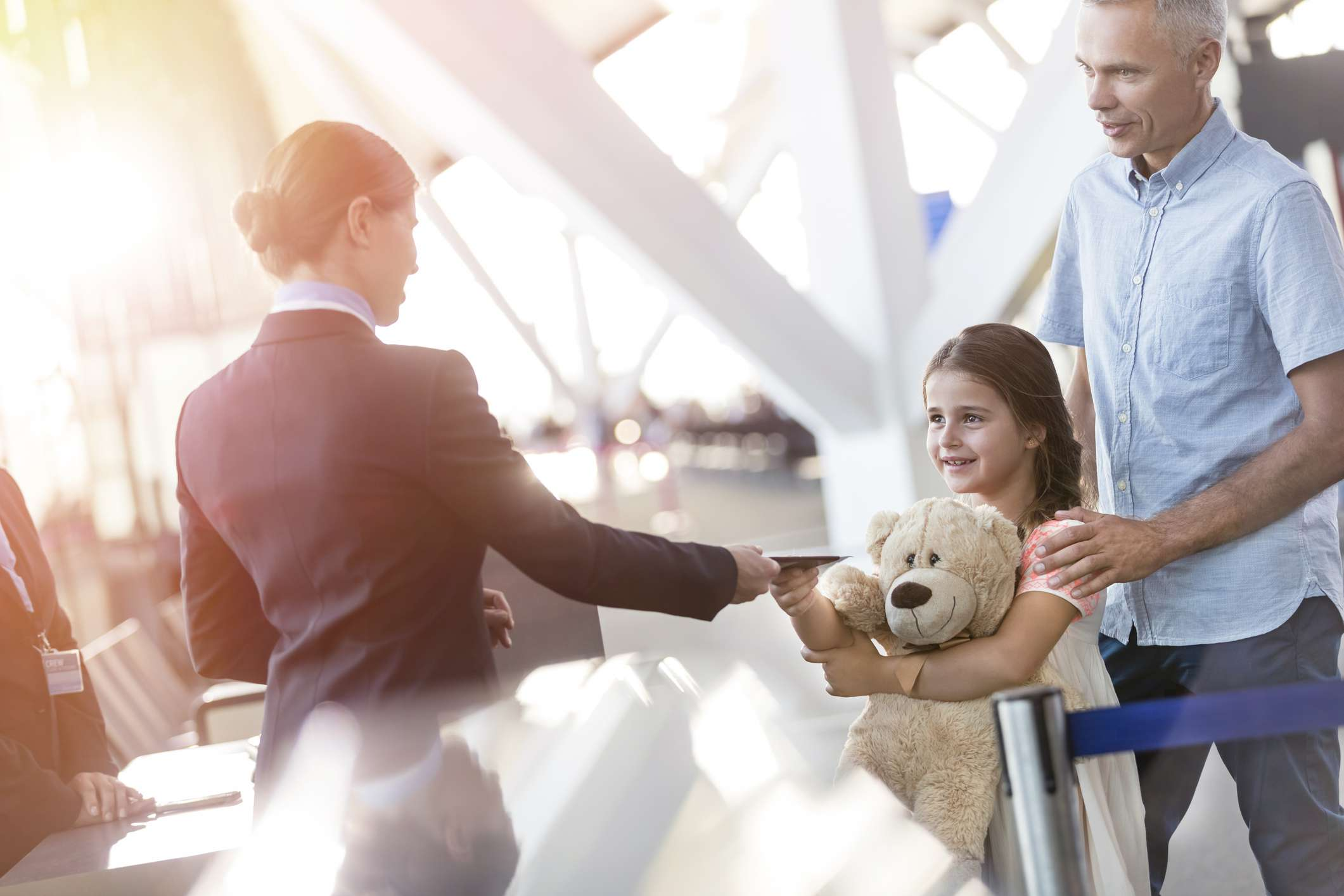 Girl with a teddy bear at airport