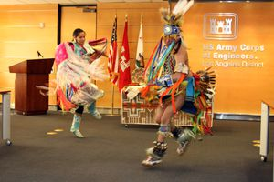 Living history performers dance at the American Indian Heritage Month at the US Army Corps of Engineers Los Angeles District