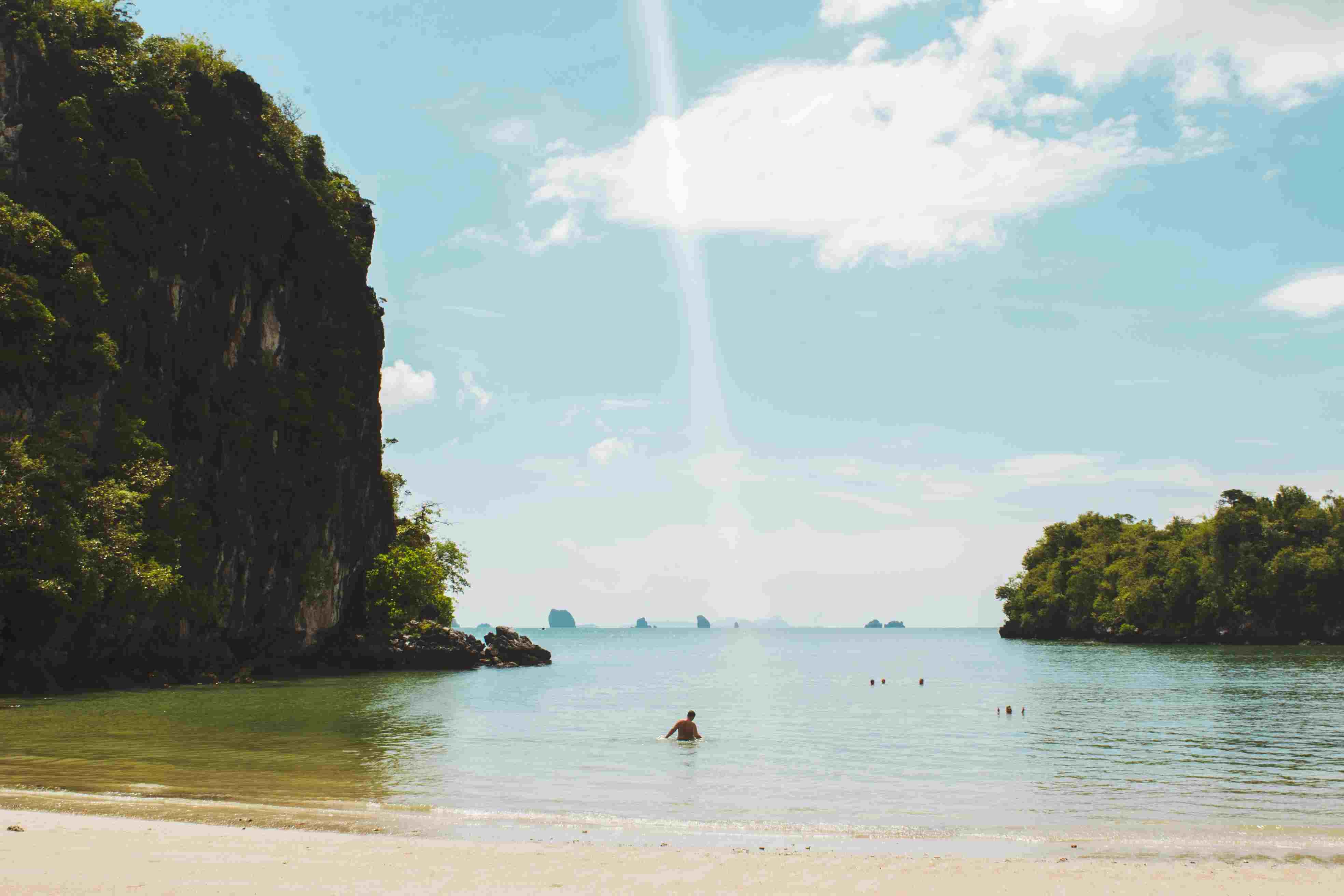 a man swimming in a lagoon in Krabi, Thailand