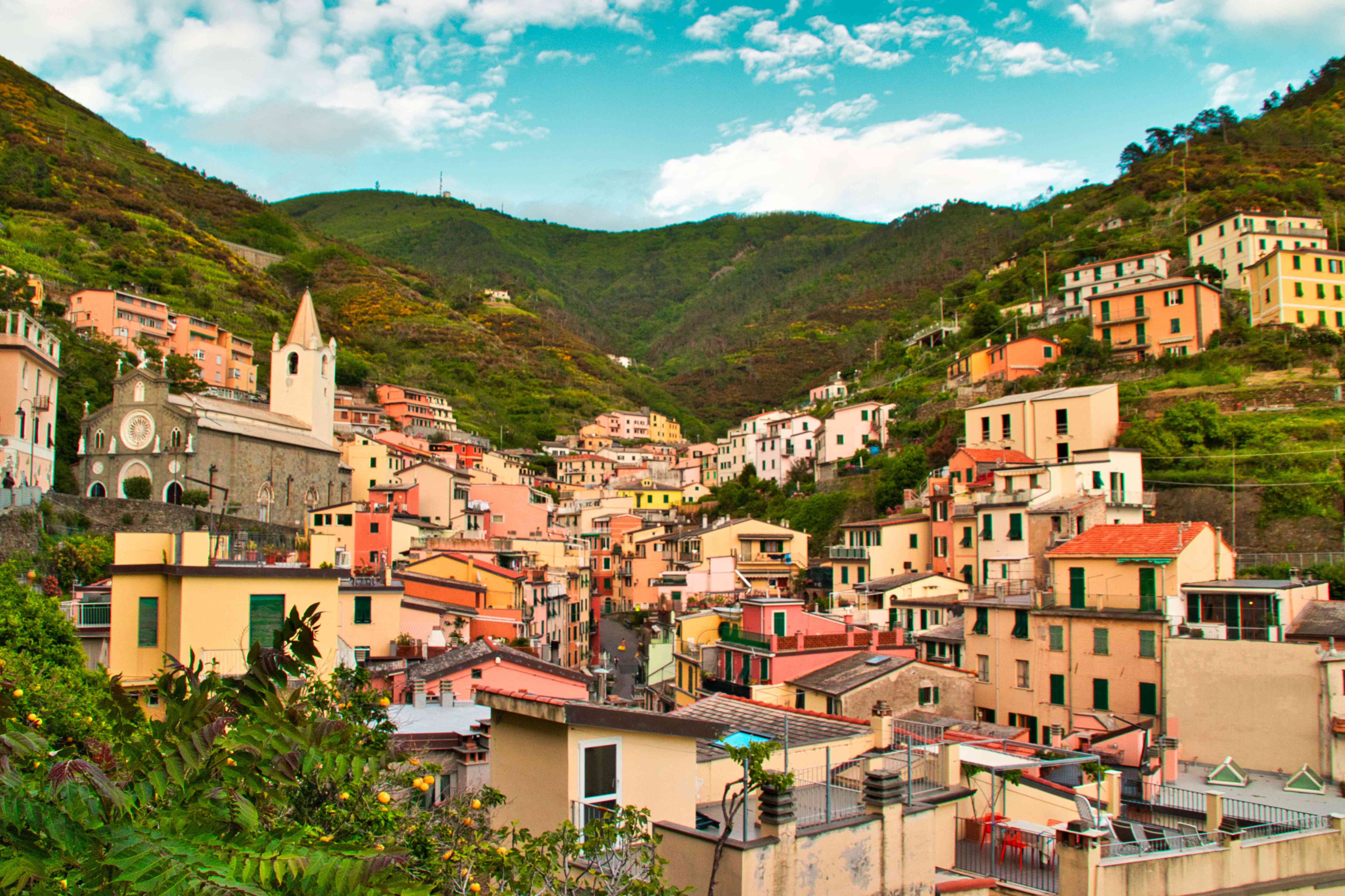 Colorful buildings in the valley of mountains in the Gulf of Poets