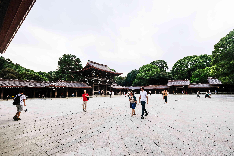 People walking through Meiji Shrine