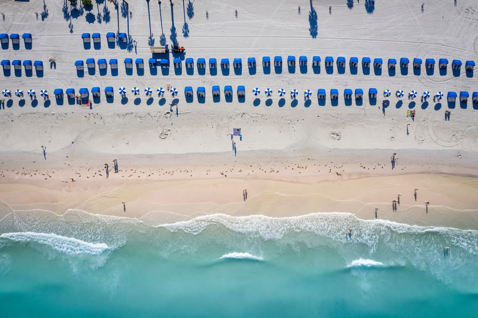 Aerial View Of Umbrellas On Beach
