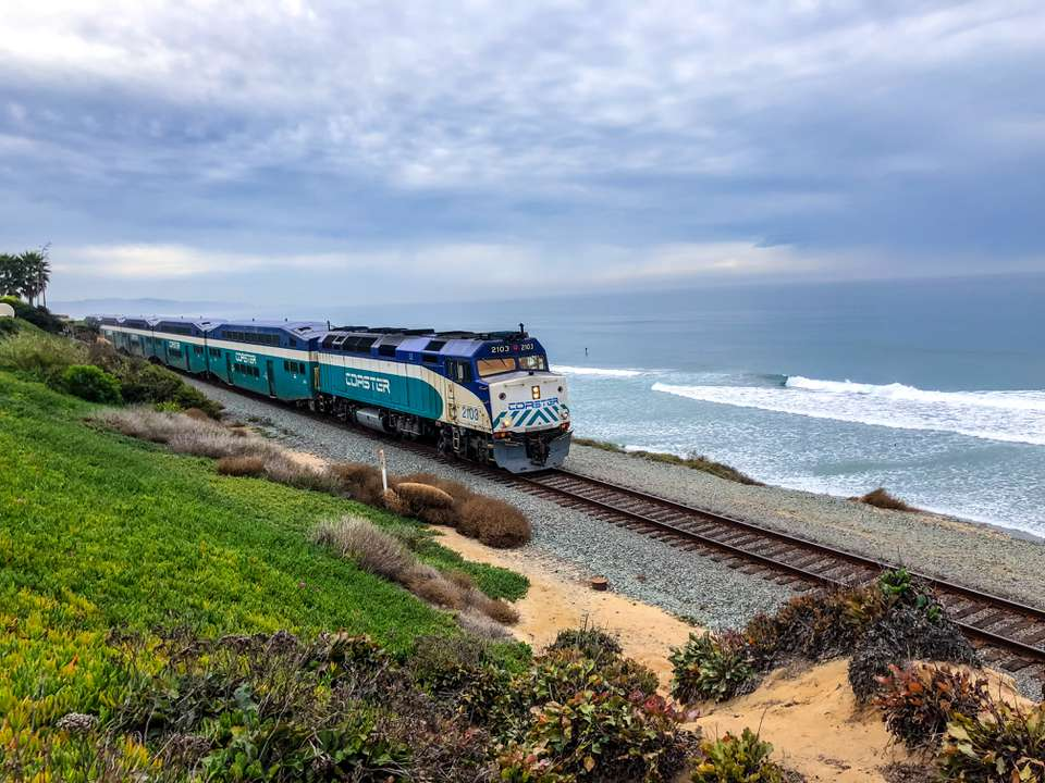 Coaster Commuter train on Del Mar beach, California, USA