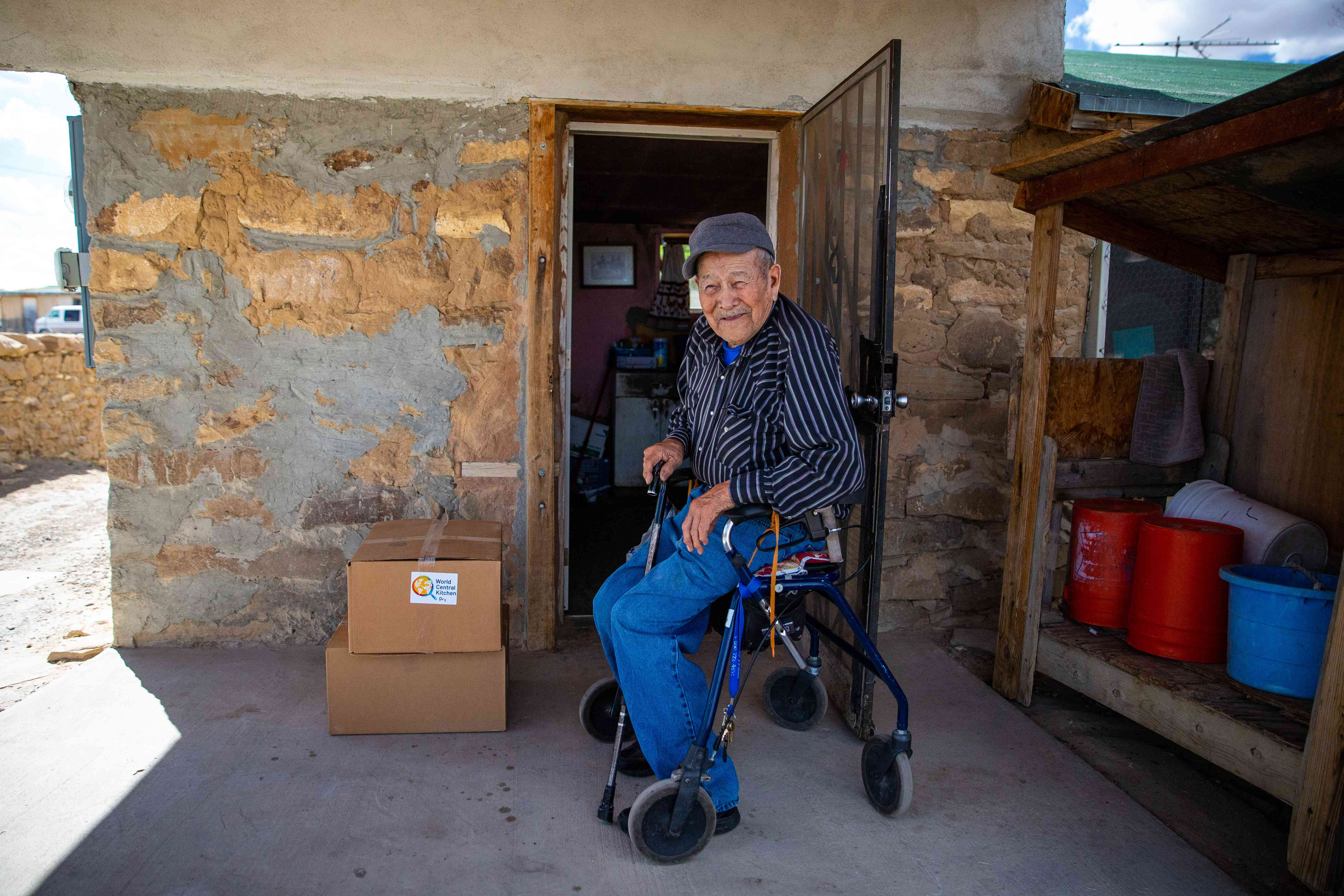 An elderly man in the Navajo nation receives a box of food from World Central Kitchen