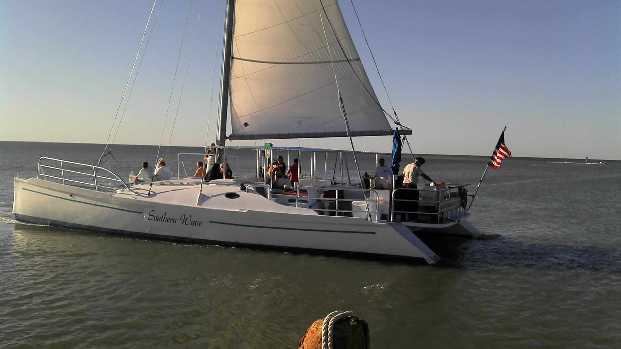 A sailboat setting off to sea on the Gulf