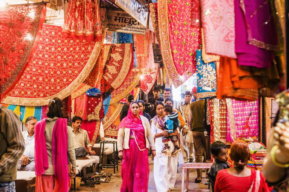 People walking at the Sari Bazaar market in Jaipur, sari, textiles and fabrics for sale