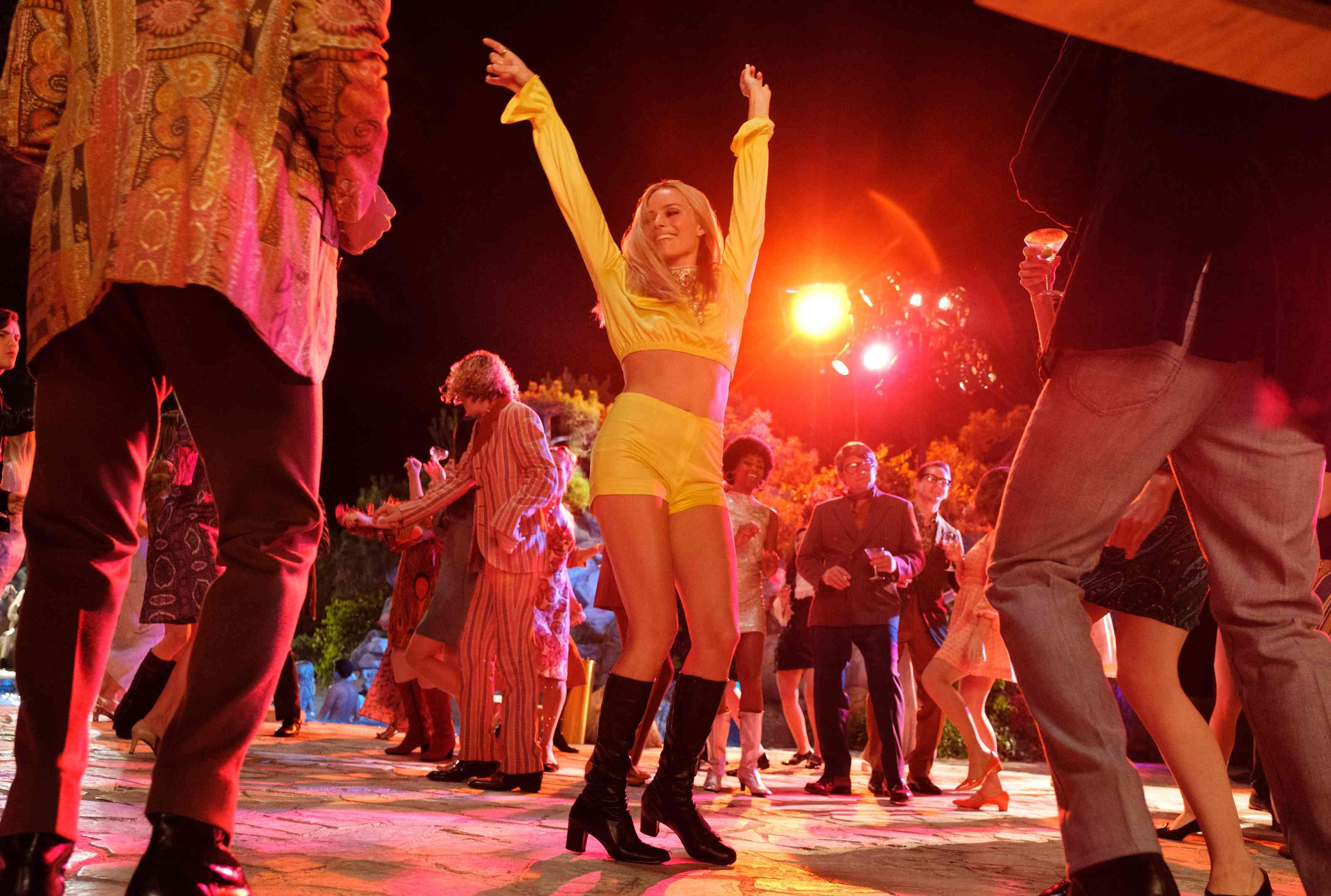 Margot Robbie dancing at the Playboy Mansion