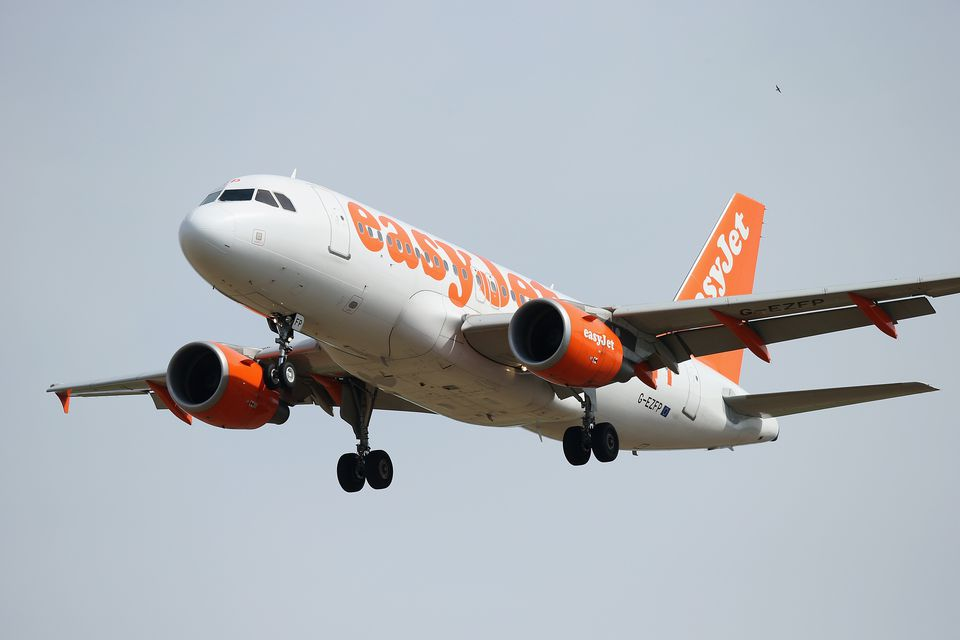 A passenger plane of discount airline easyJet arrives at Schoenefeld Airport, which is adjacent to the new Willy Brandt Berlin Brandenburg International Airport, on August 16, 2013 in Schoenefeld, Germany.
