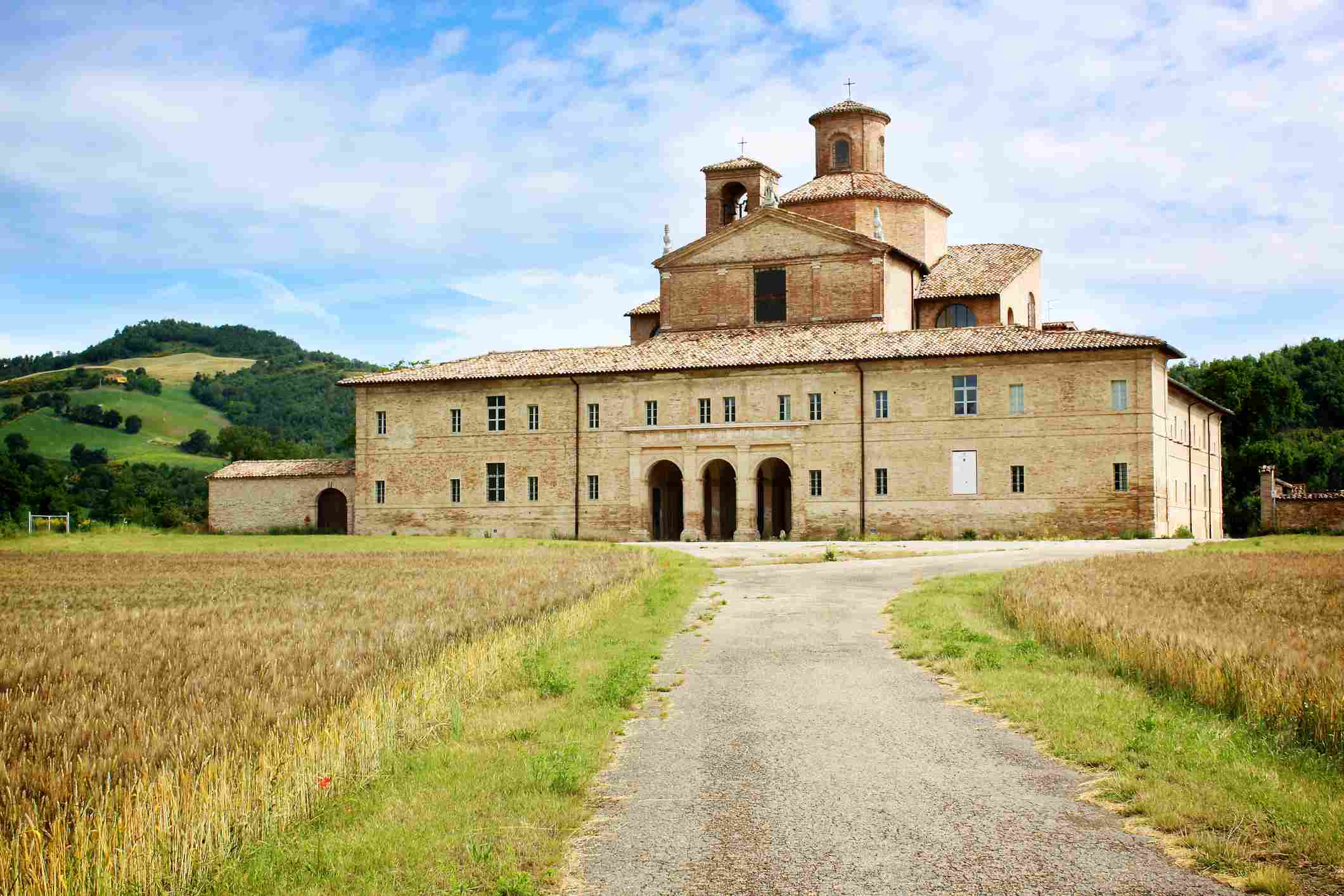 Old monastery with hills in background, Urbania, Marche, Italy