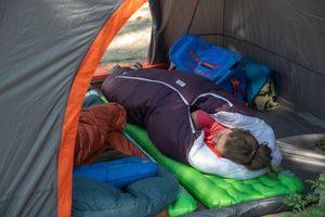 A woman sleeping in a Big Agnes sleeping bag in a Big Agnes tent