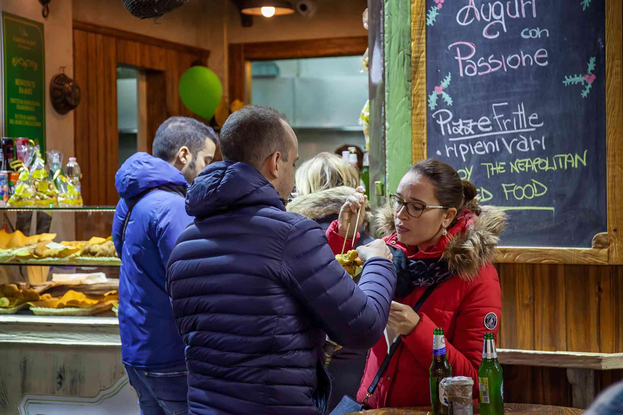 People enjoying street food in Naples