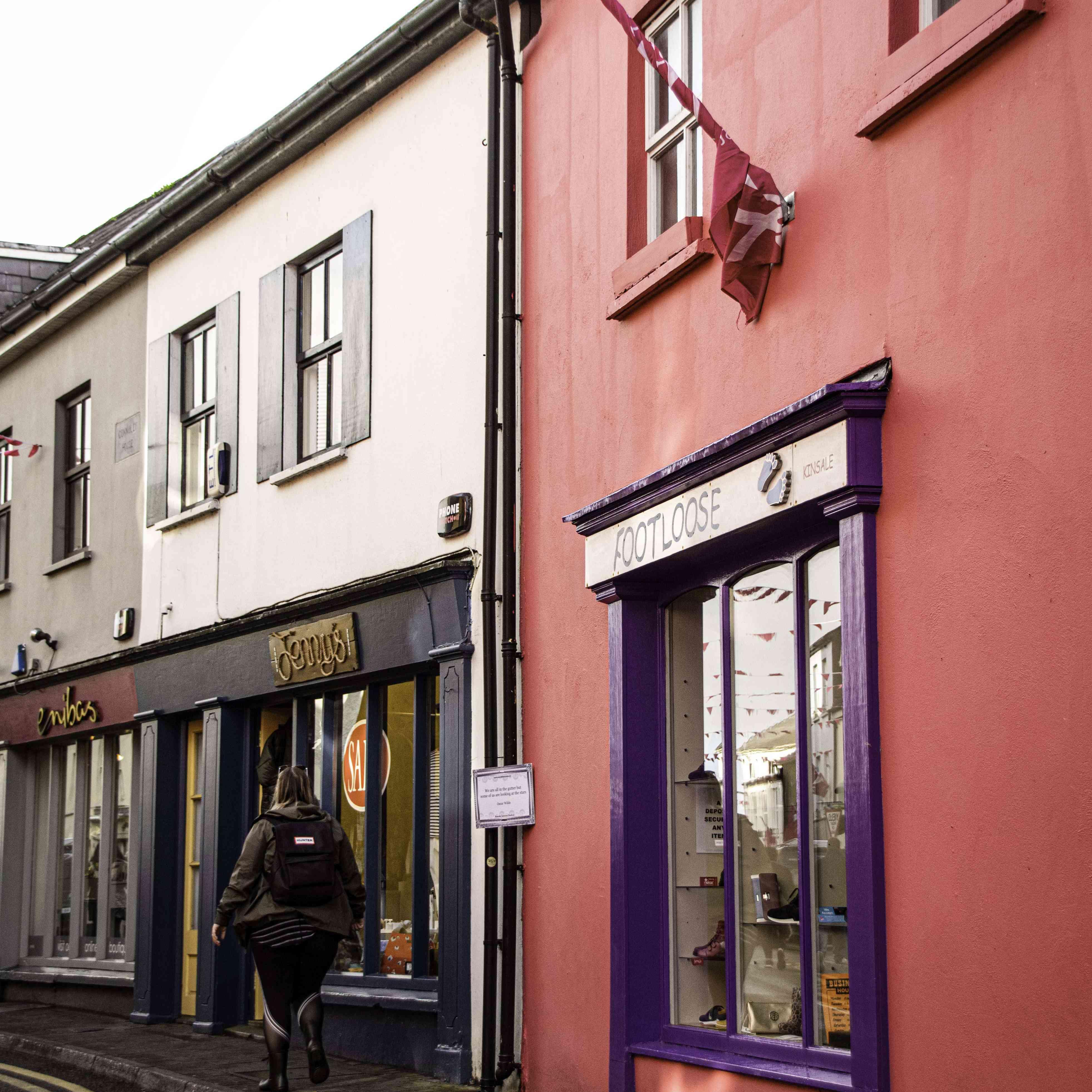 A woman walking down the street in Kinsale