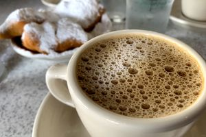 A cup of coffee and donuts from Cafe Dumont