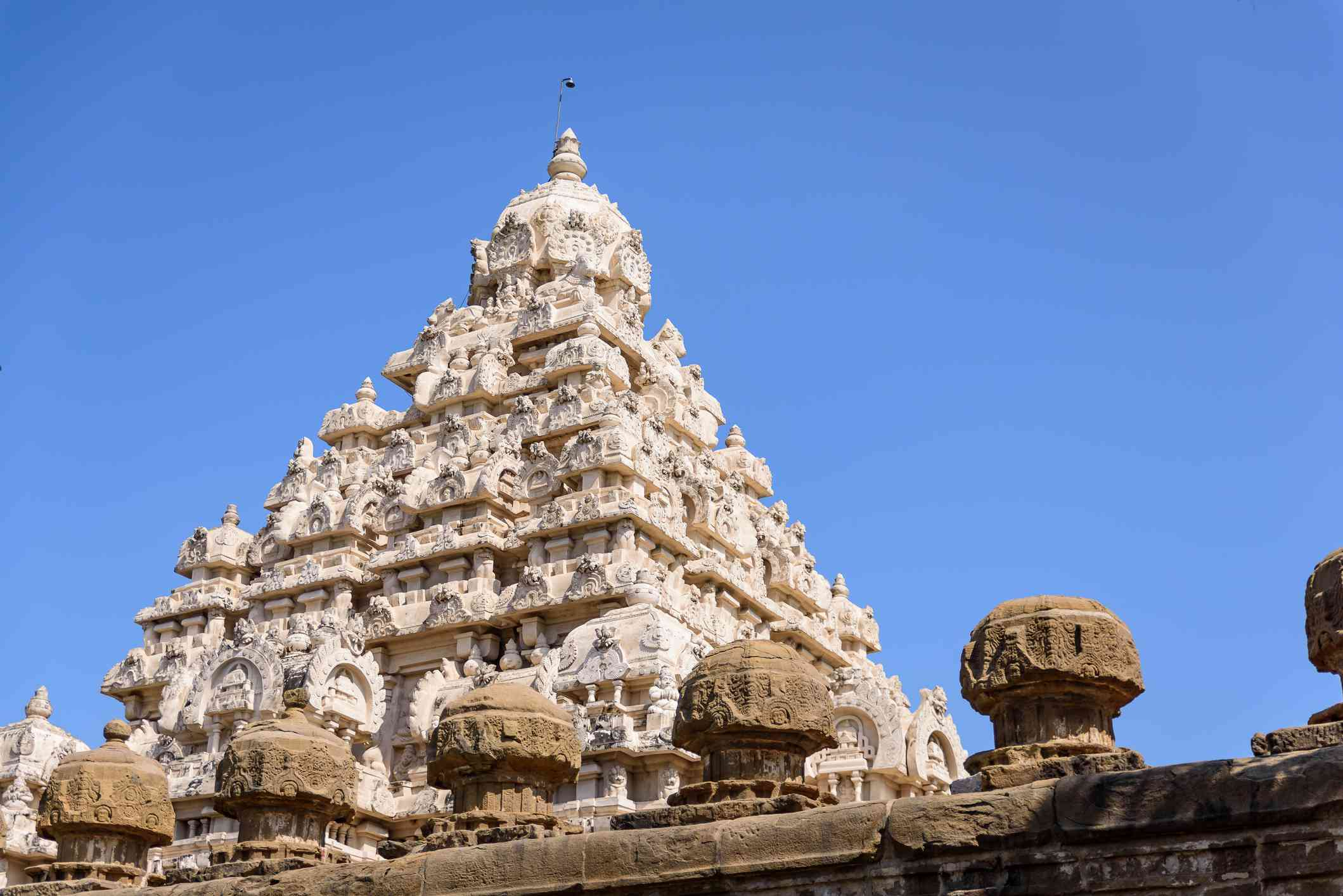 Low-angle view of a white Hindu temple (Shiva temple), India