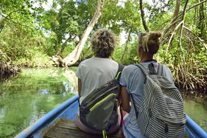 Dominican Republic, Samana, two women in a boat in mangrove lagoon