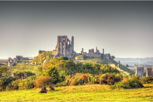 View of Corfe Castle in Dorset, surrounded by rural farmland