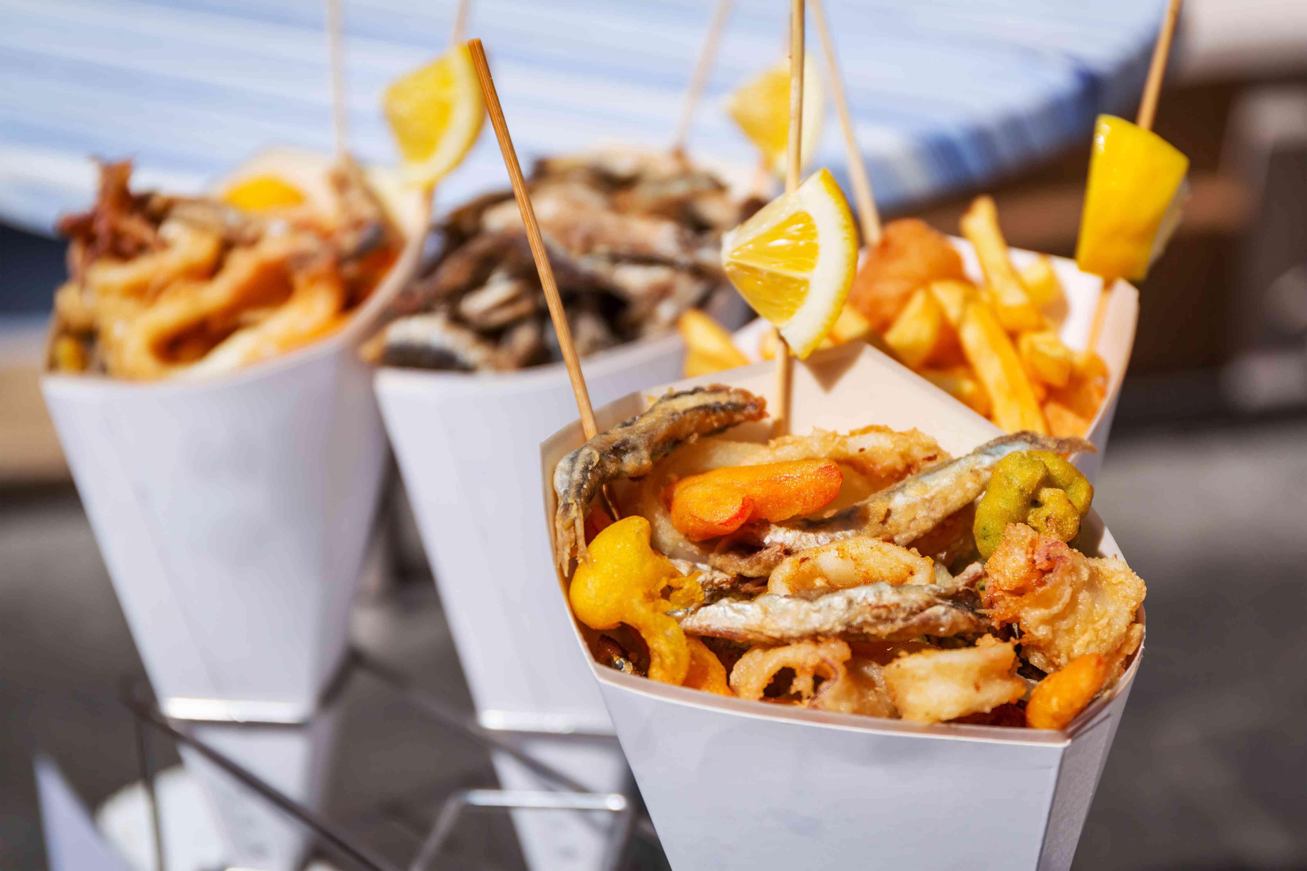 Sea food in cones on the street in riomaggiore