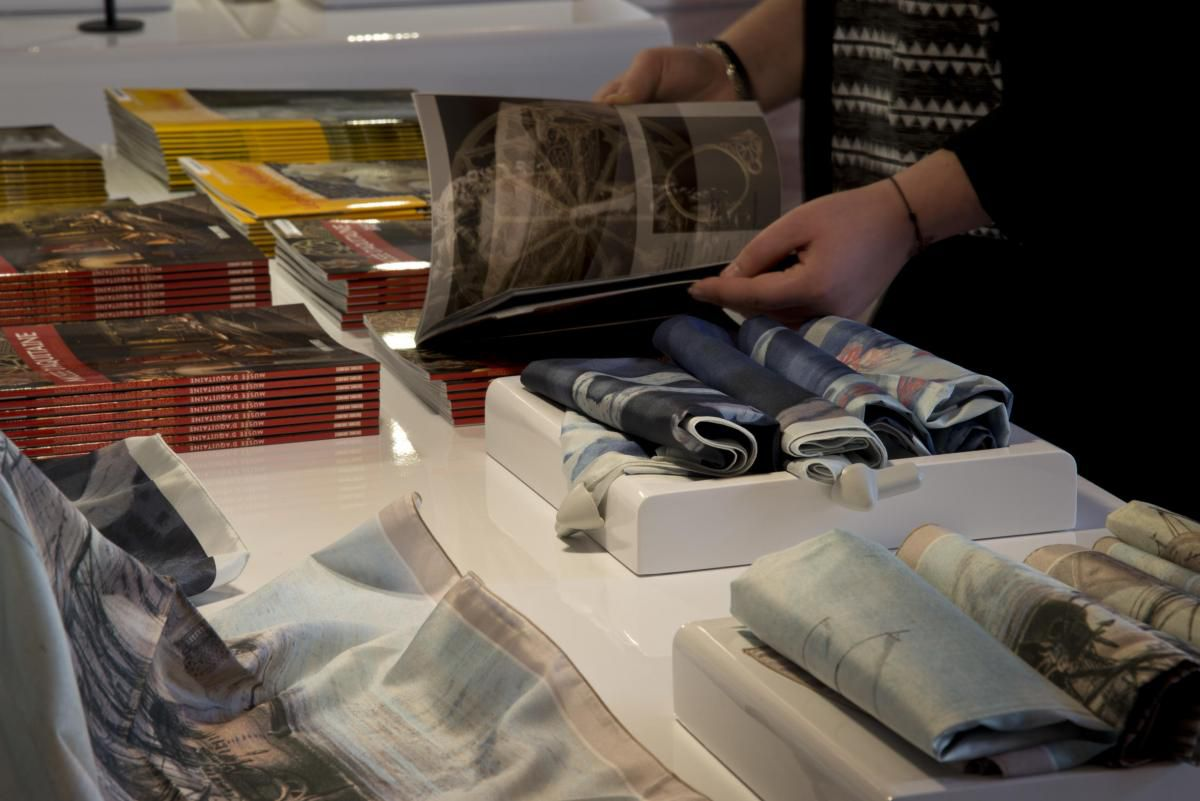A museum-goer browses gifts at the Musée d'Aquitaine boutique