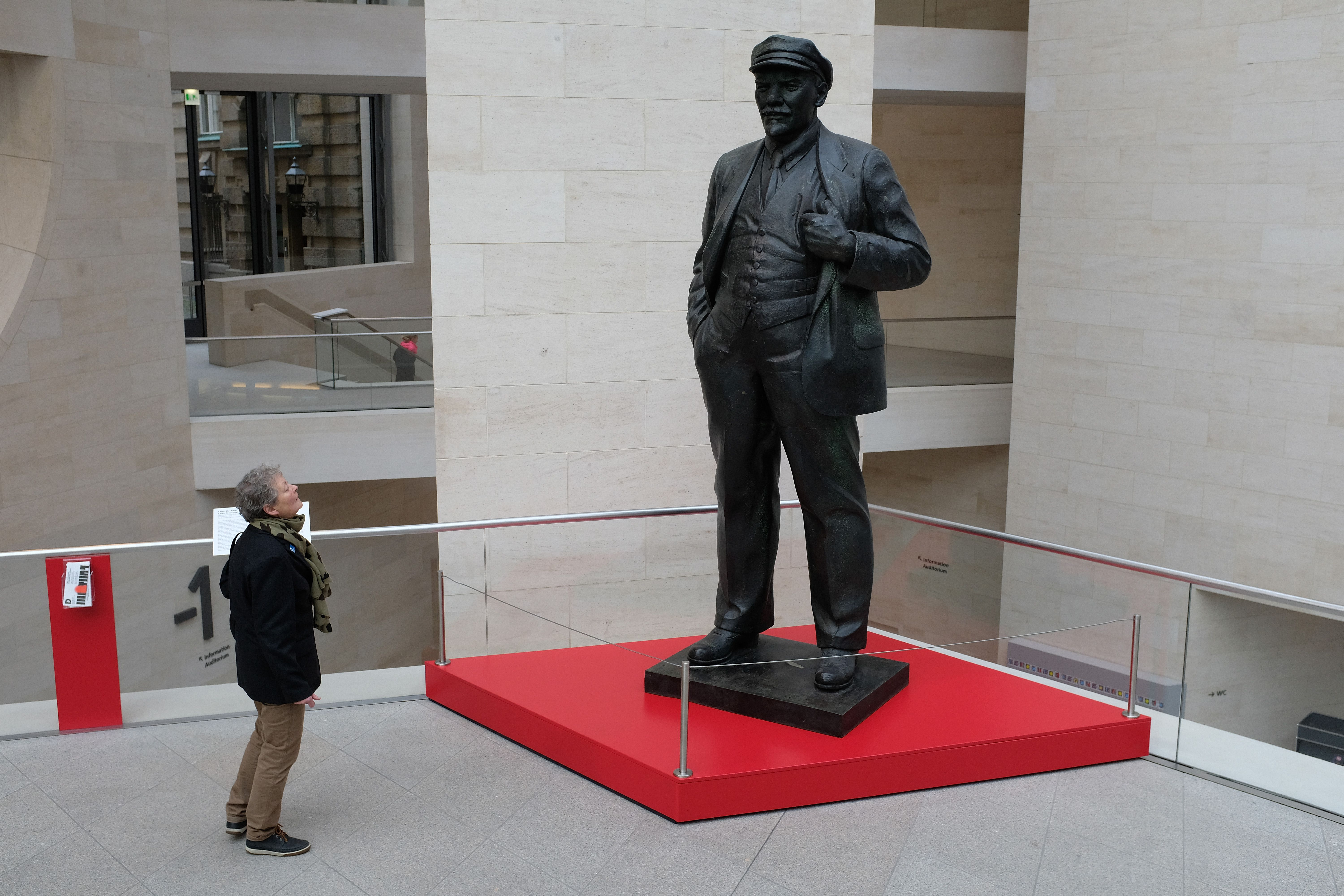 a man admiring a statue in the Soviet Museum