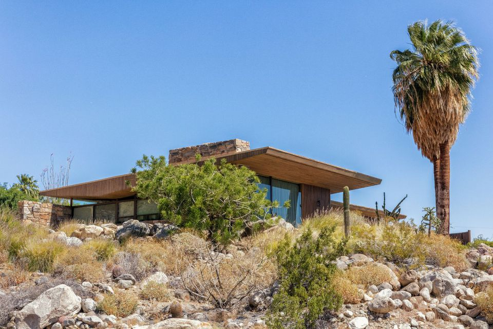 Edris House surrounded by rocks