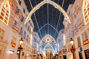 lights and decorations over the main shopping street Andalucia Avenue, Malaga, Spain