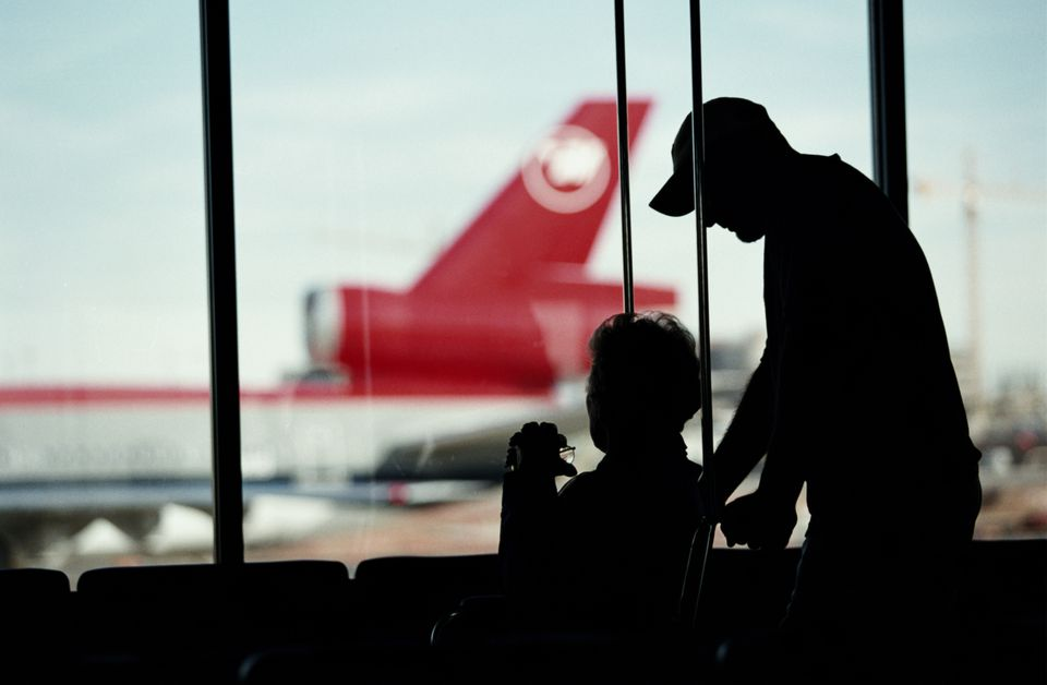 Silhouette of woman in wheelchair at the airport