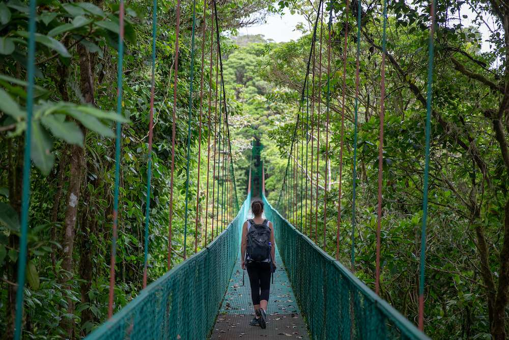 A woman walking through the jungle canopy in Costa Rica