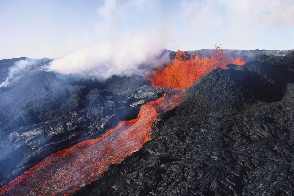 Mauna Loa Volcano Eruption With Lava Flow And Steam Rising