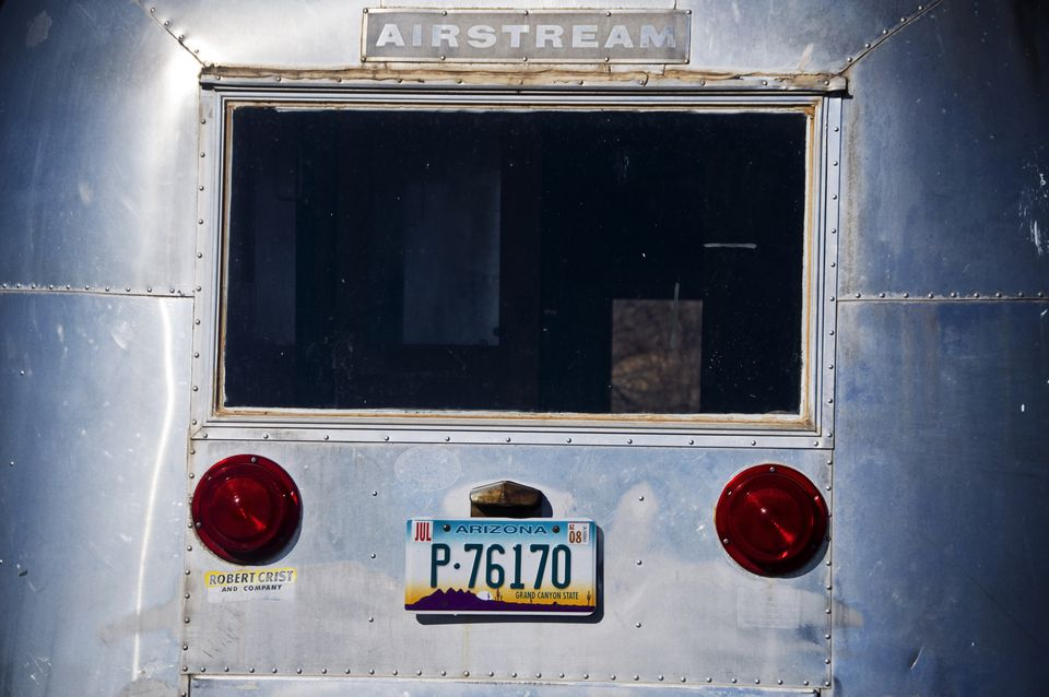 Rear image of an old Airstream travel trailer