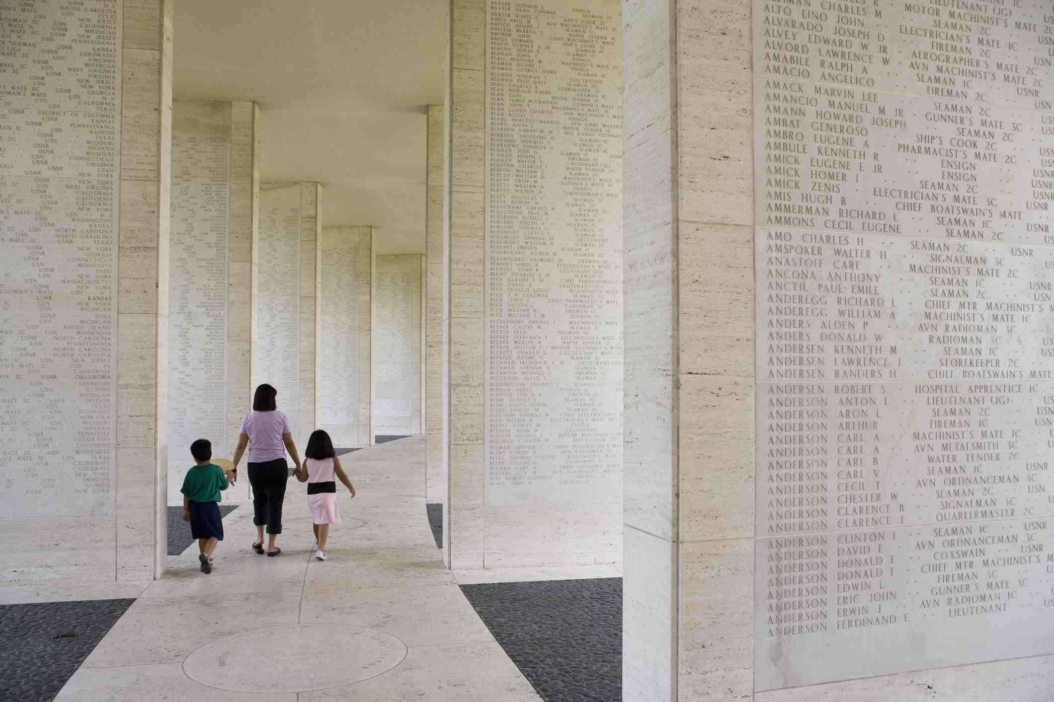 Family walking amidst the Tablets of the Missing, Manila American Cemetery