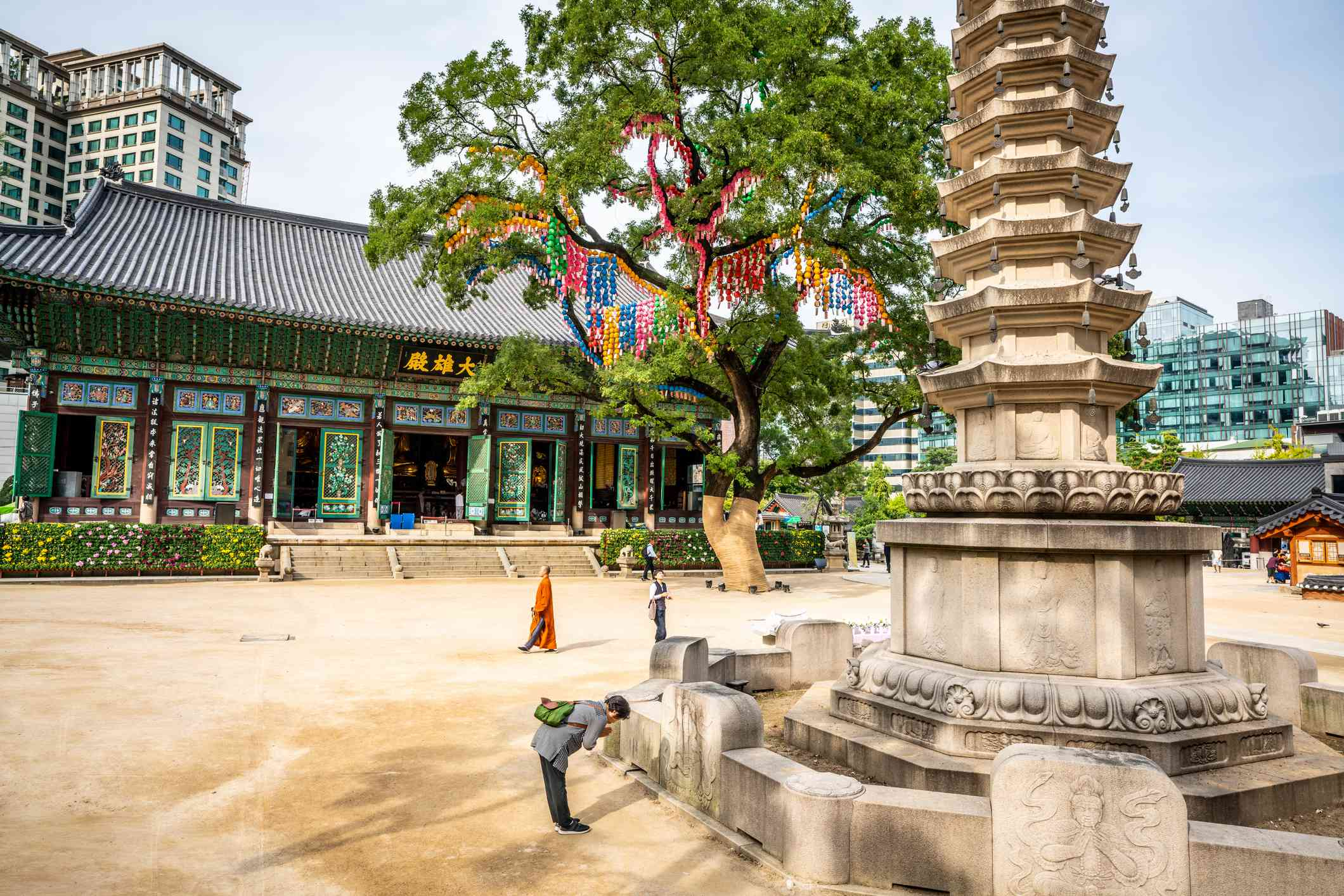 Jogyesa temple view with the Daeungjeon hall the pagoda tree and people praying in Seoul South Korea