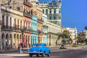 Street in Cuba featuring 16th century architecture and vintage cars