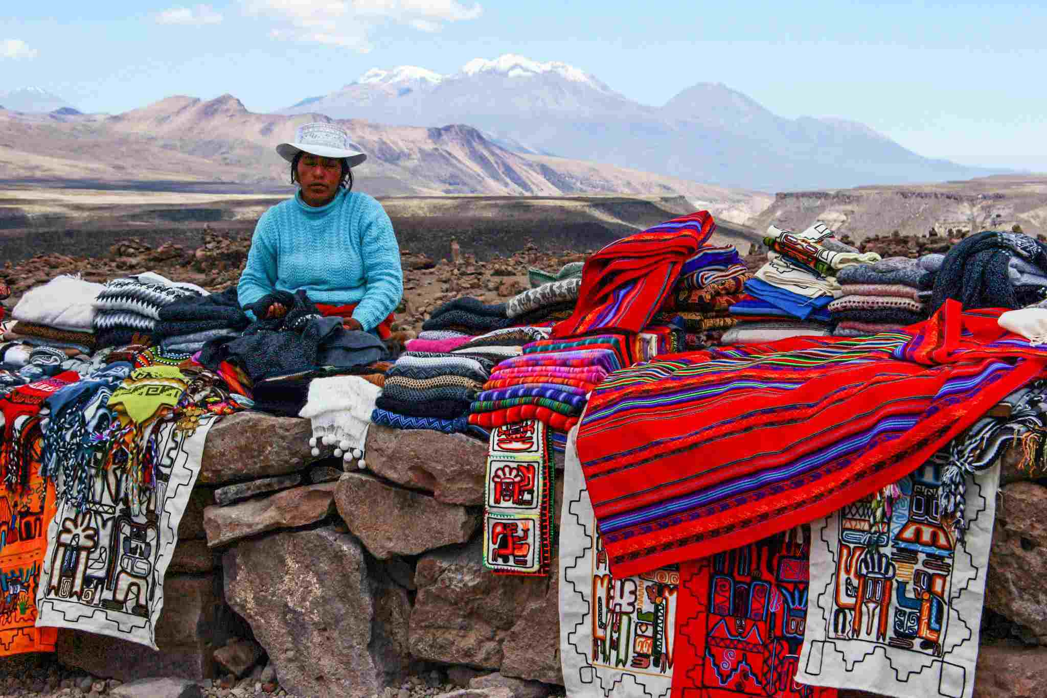 A woman selling traditional Peruvian blankets in Colca Canyon