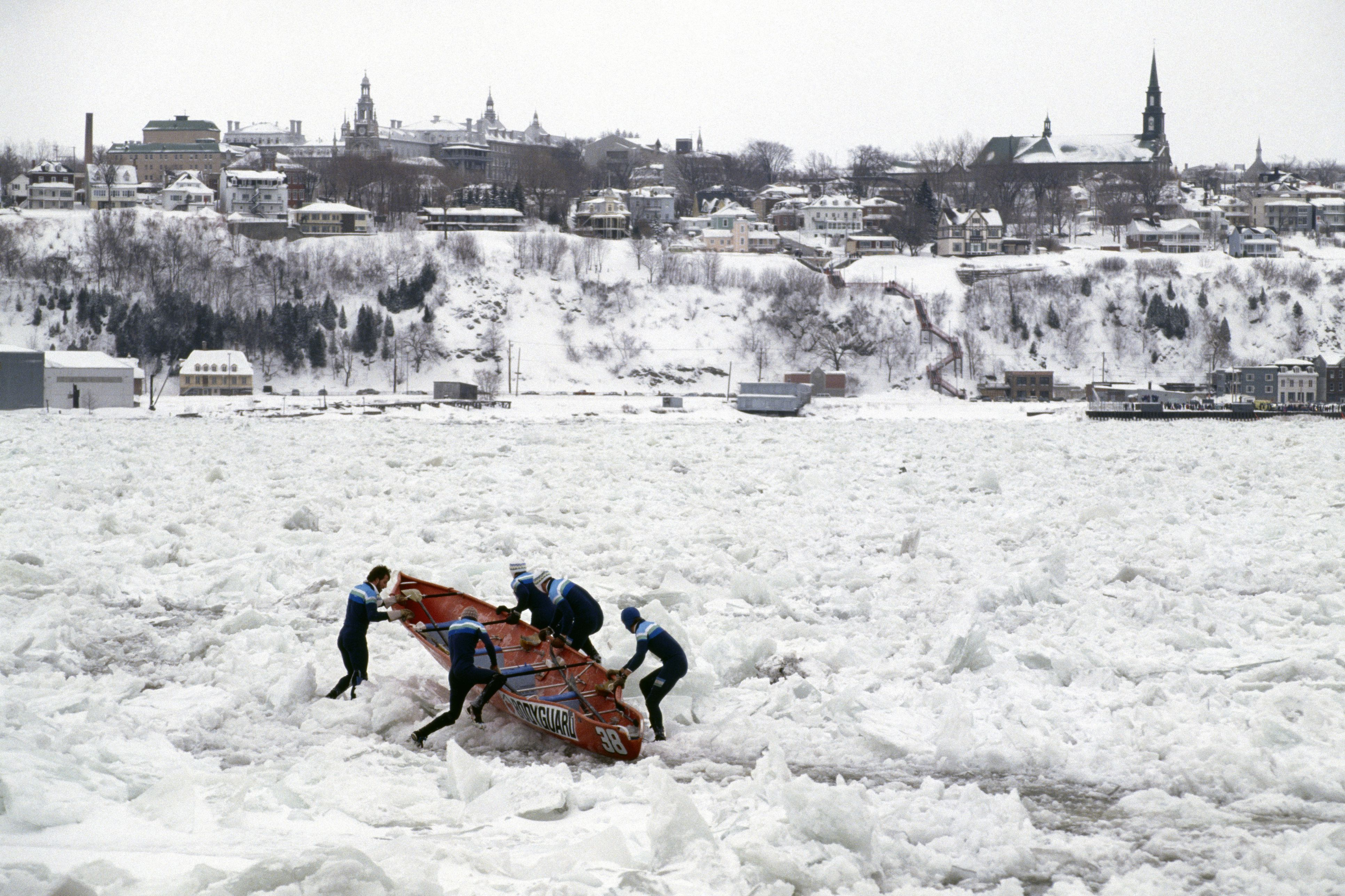 A group of boaters participate in an iced river crossing competition in Quebec city
