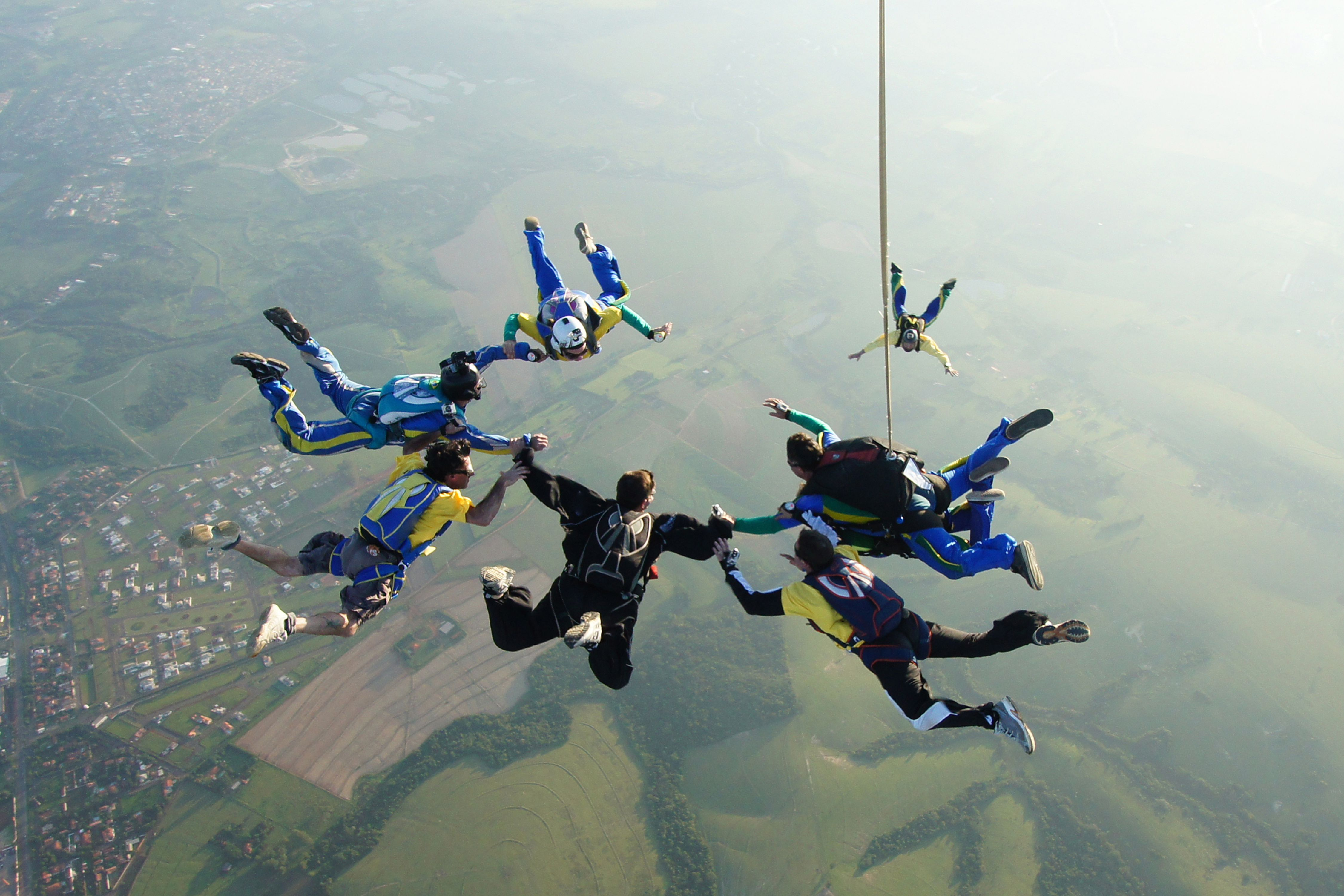 A group skydiving over Sao Paulo
