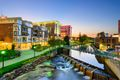 View of the Reedy River and buildings in downtown Greenville at sunset