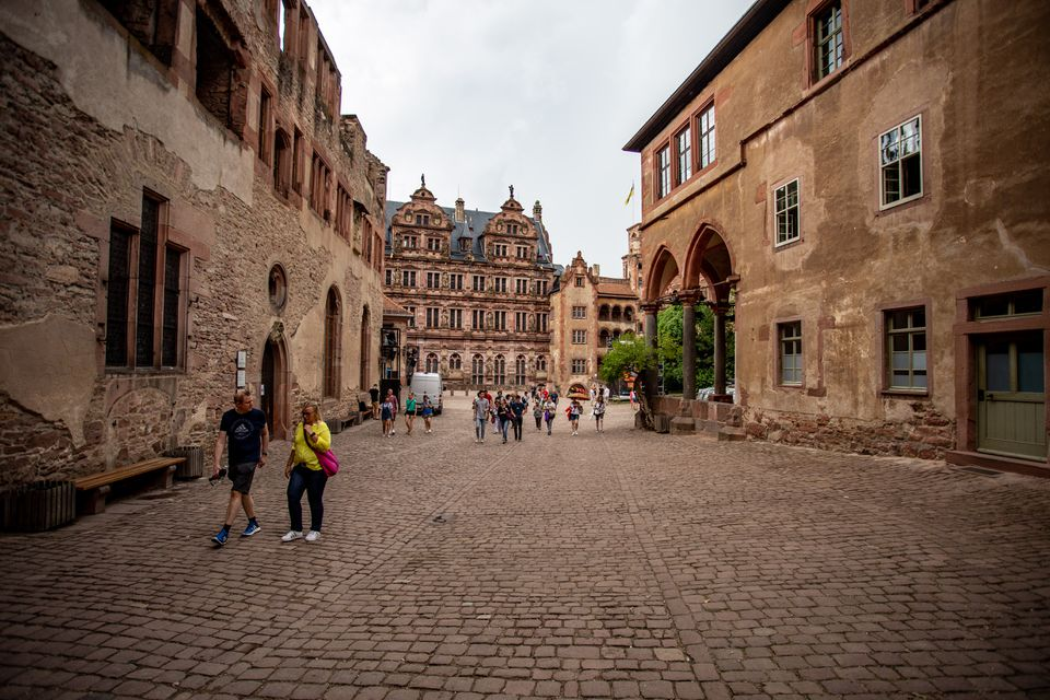 People walking around inside Heidelberg Castle