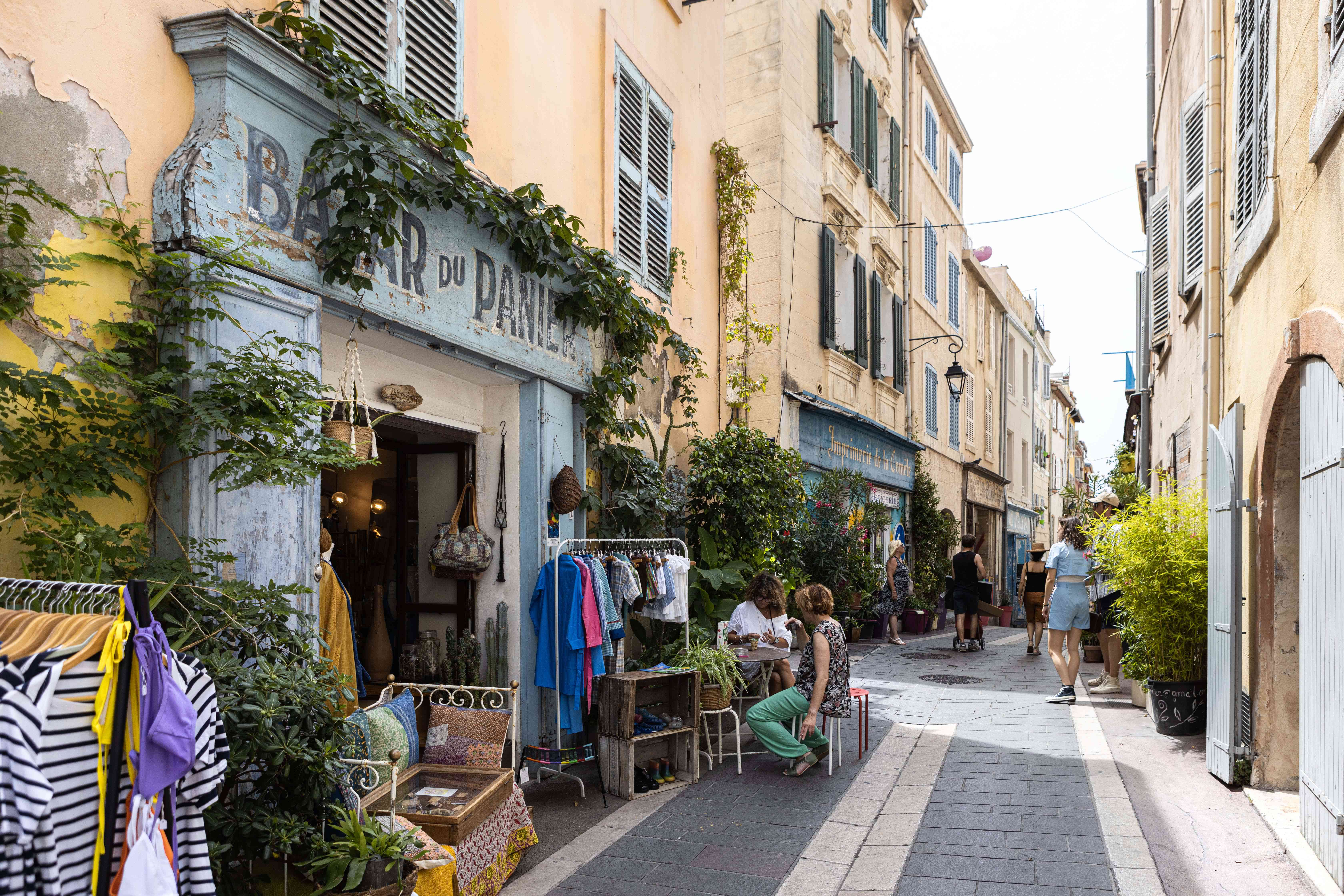 A street cafe and street shops in Marseille
