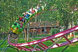 Kids riding the dragon rollercoaster at Storybook Land