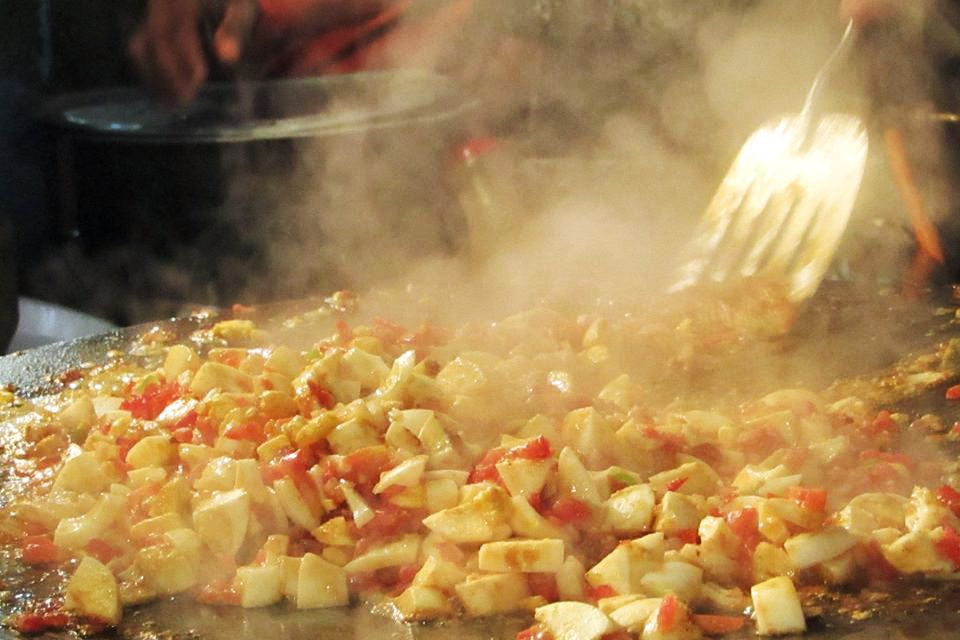 steaming hot cooktop with diced, boiled eggs