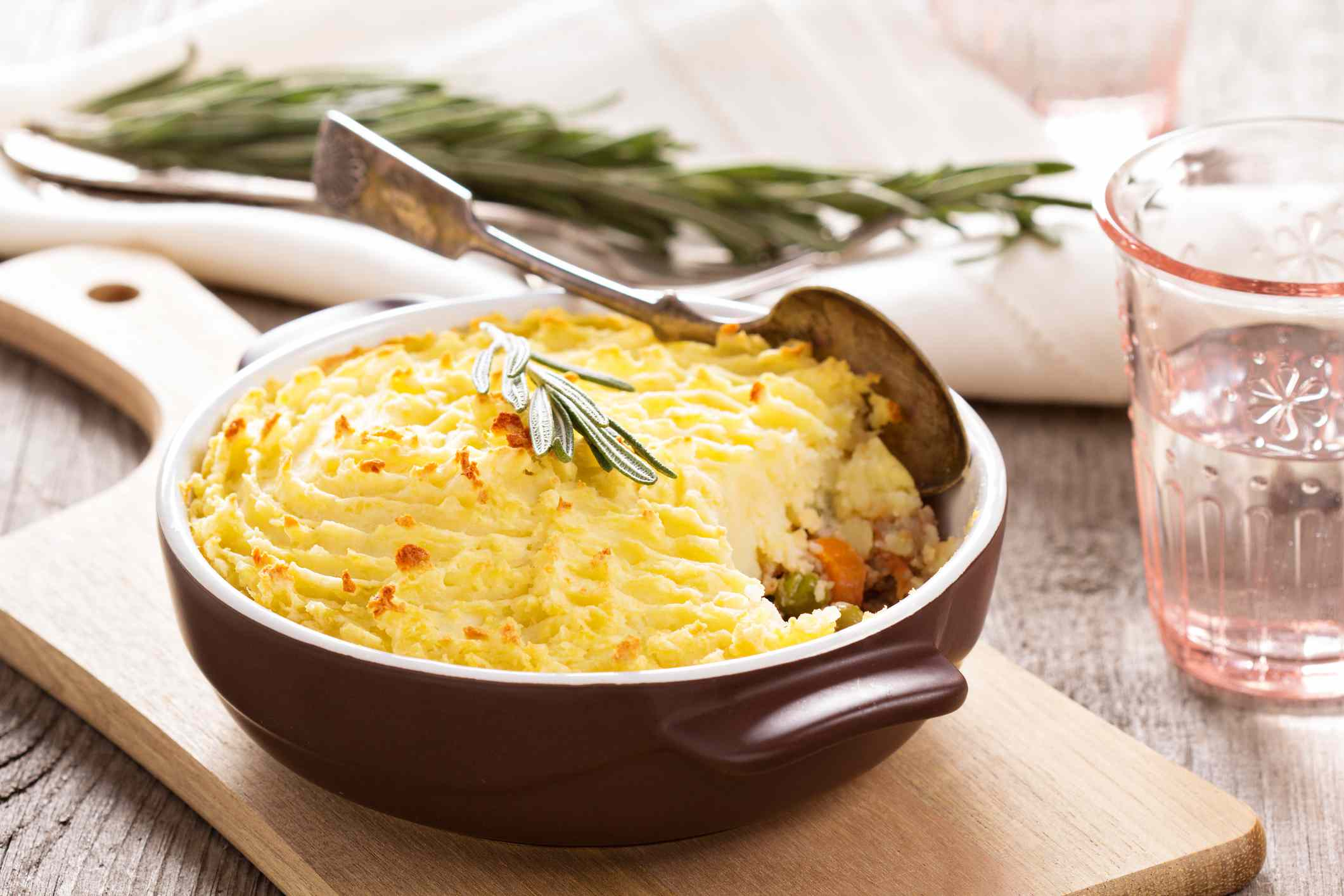 Dish of shepherds pie ready to be served on a cutting board