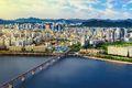 Aerial shot of Seoul City Skyline and N Seoul Tower with traffic bridge, South Korea